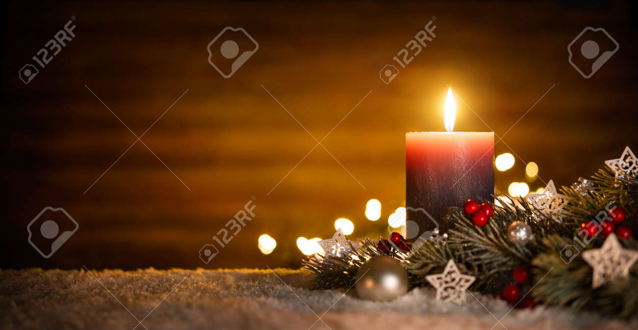Burning candle and Christmas decoration over snow and wooden background, elegant low-key shot with festive mood - 65438162