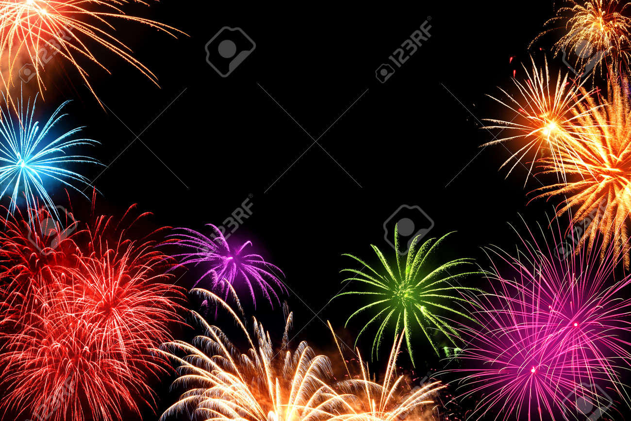 gorgeous multi colored fireworks as a border on black background ideal for new year