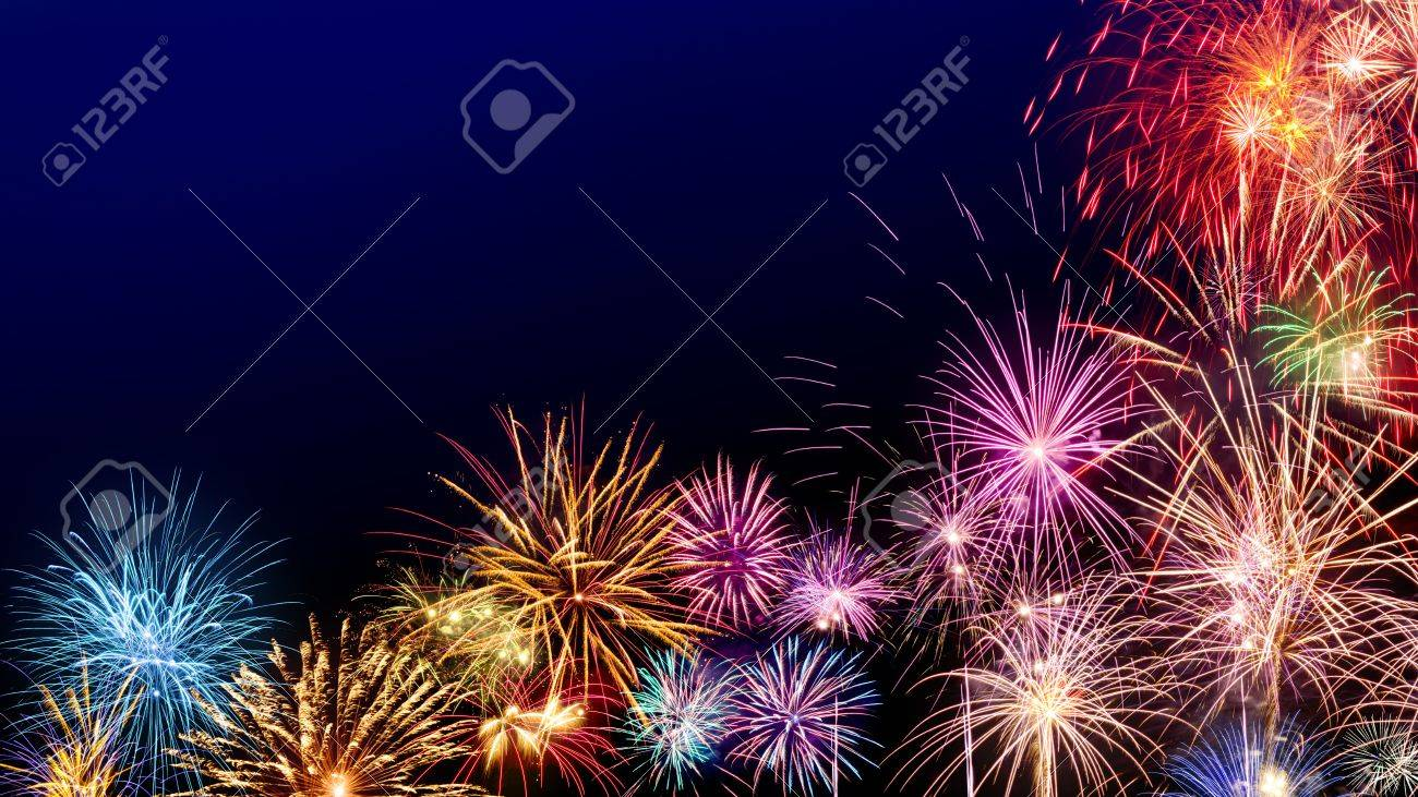 Multi-colored fireworks as a border on dark blue background, ideal for New Year or other celebration events - 69689447