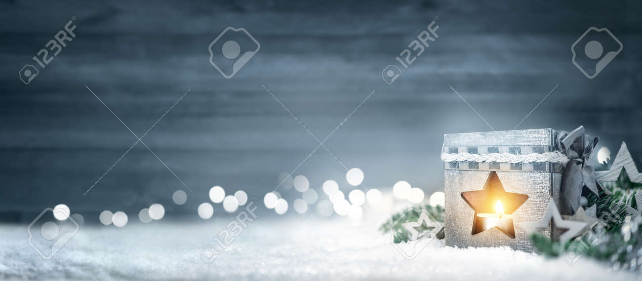 Christmas background in cool winter colors with a shining lantern, wood board, fir branches, ornaments and out of focus lights - 88755582