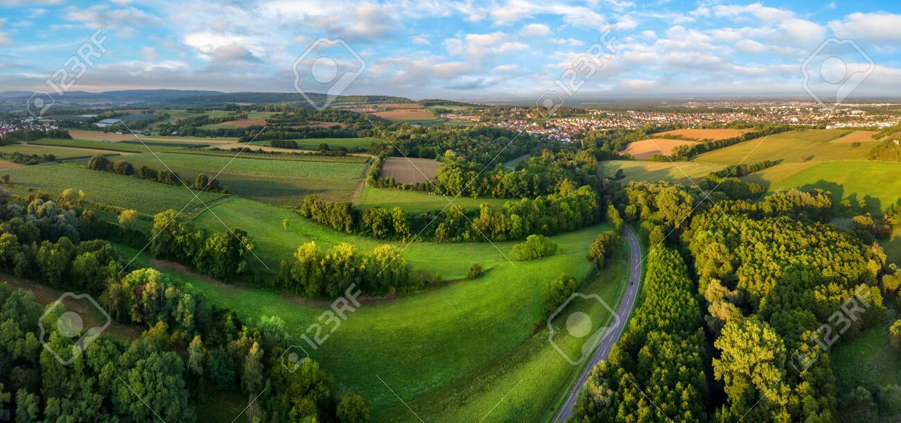 Gorgeous aerial landscape panorama after sunrise: European meadows and forests with blue sky and leading lines - 145205018