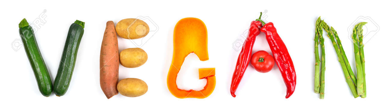 The lettering vegan arranged with different colorful vegetables on white: zucchini, potatoes, butternut squash, red peppers and asparagus. Concept studio shot - 148964168