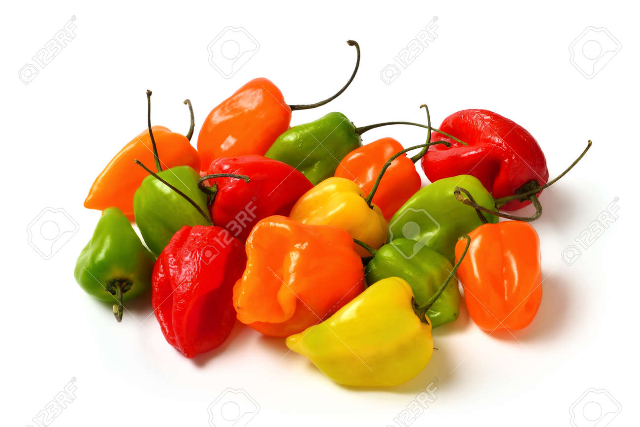 Colorful hot small chili peppers isolated in studio on white, in red, yellow, orange and green - 150001715