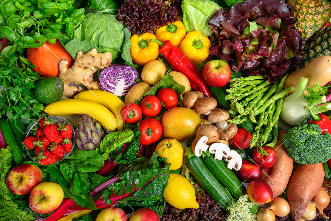 Pile of fruits and vegetables in many appetizing colors, shot from above, inviting to lead a healthy plant-based lifestyle and self-care - 150180855