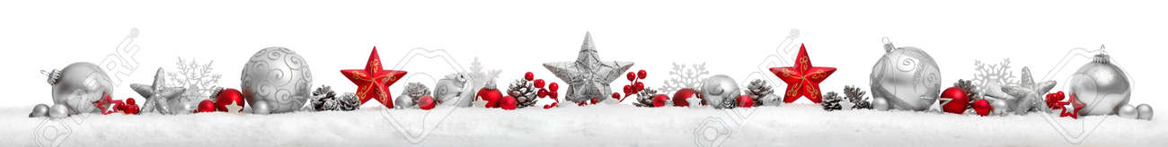 Christmas border or banner with stars and baubles arranged in a row on snow, extra wide and isolated on white background - 158220799