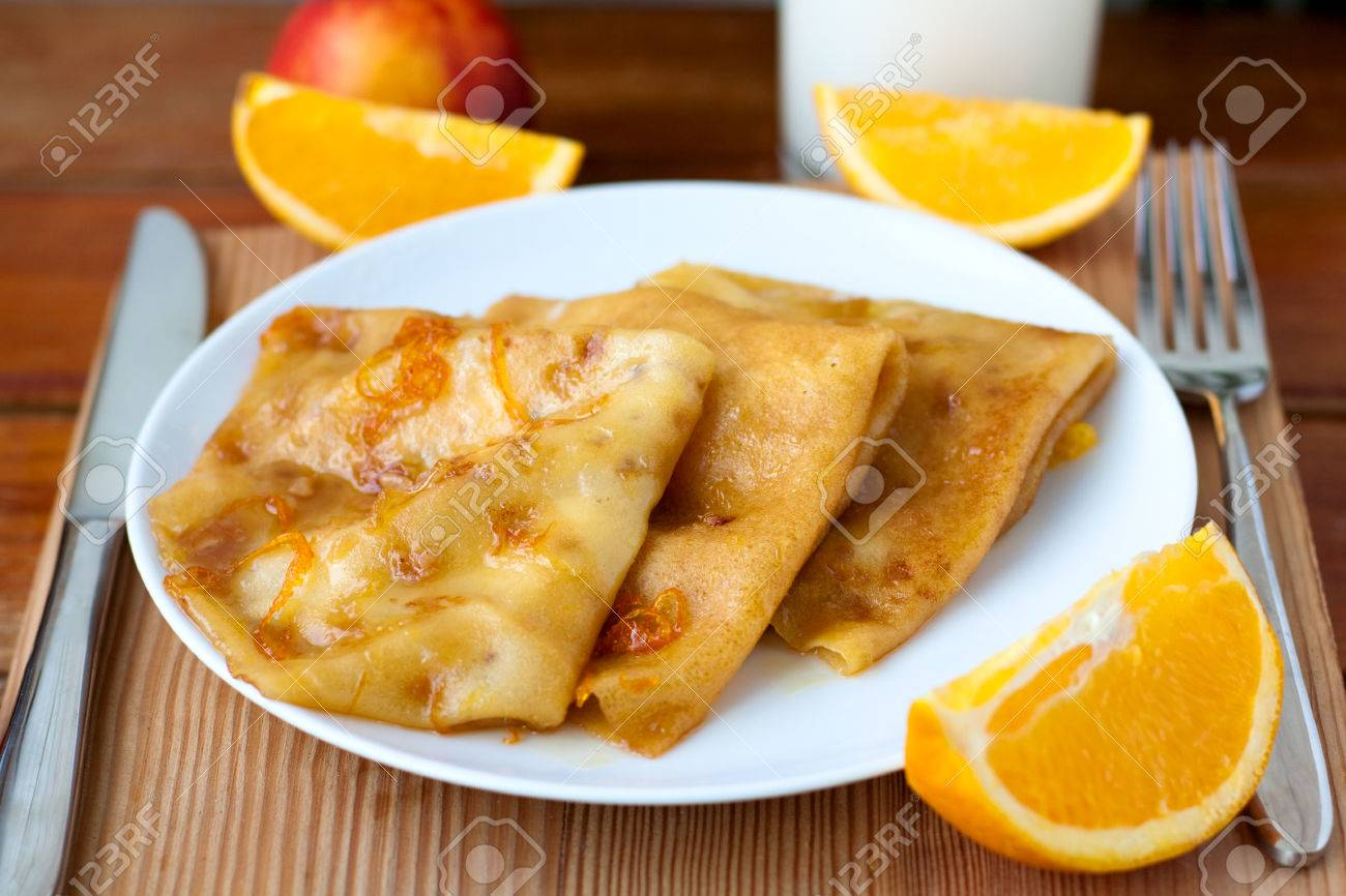 Dessert - crepes Suzette with orange syrup - 31484385