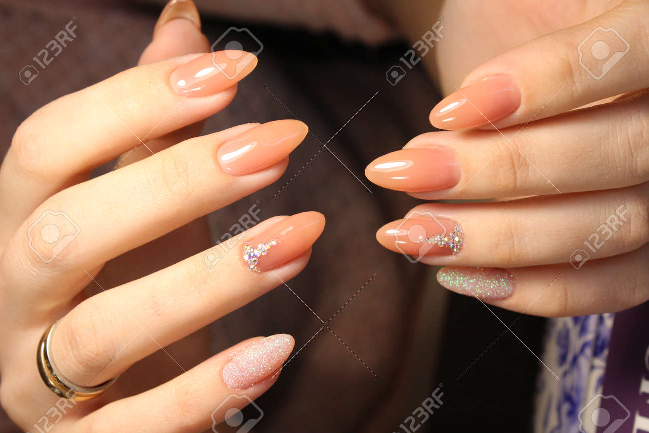 Manicure Design Of Natural Color On The Exfoliated Nails Stock Photo ...