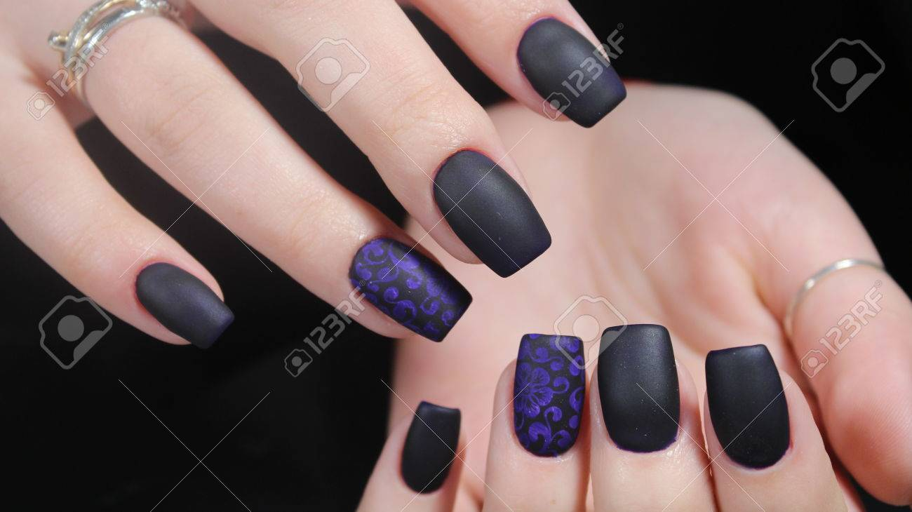 Design Of Manicure Matt Black And Blue Nails Stock Photo, Picture ...