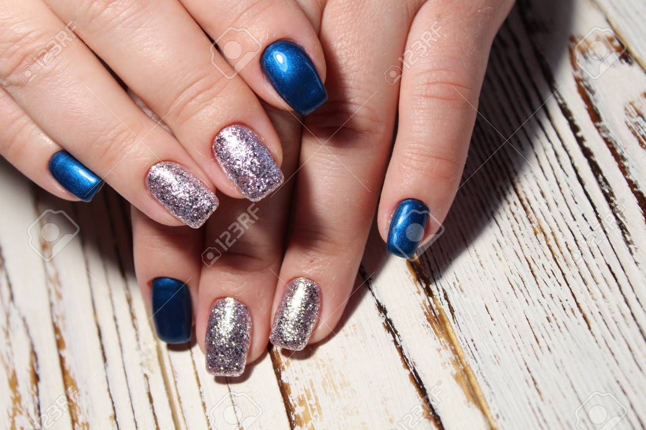 Christmas design manicure with snowflakes at the end of the nails. Stock Photo - 92293857
