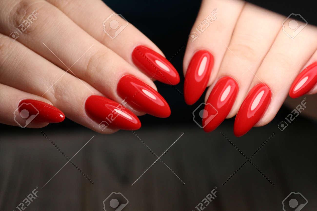 Fashion nails manicure on beautiful hands - 120553345