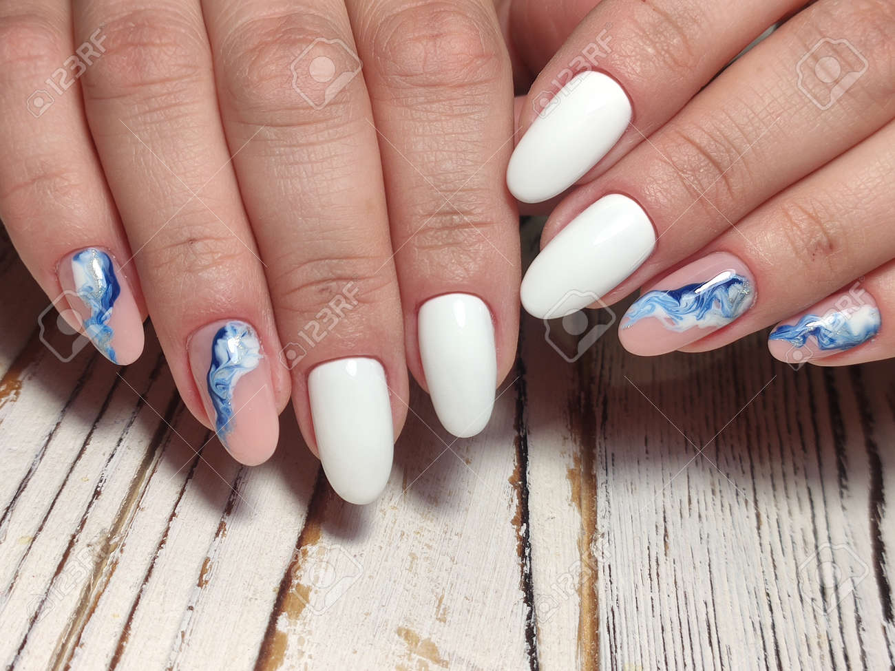 Trendy manicure design on a beautiful textural background. - 145221743