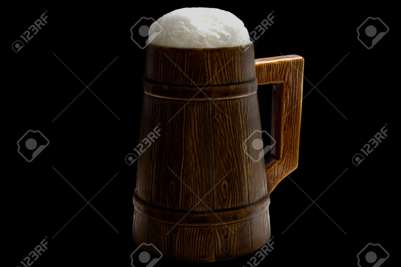 Glass of beer with foam on a black background Stock Photo - 1415058