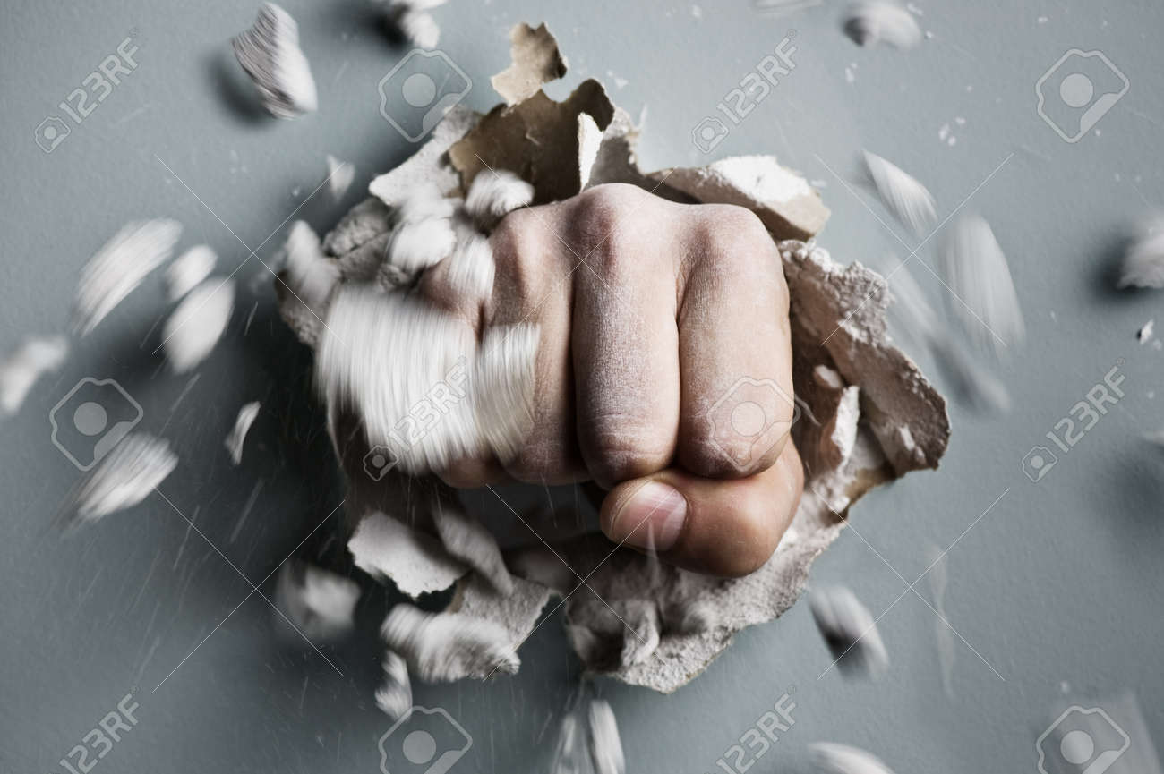 a wall is broken through by a fist Standard-Bild - 17434949