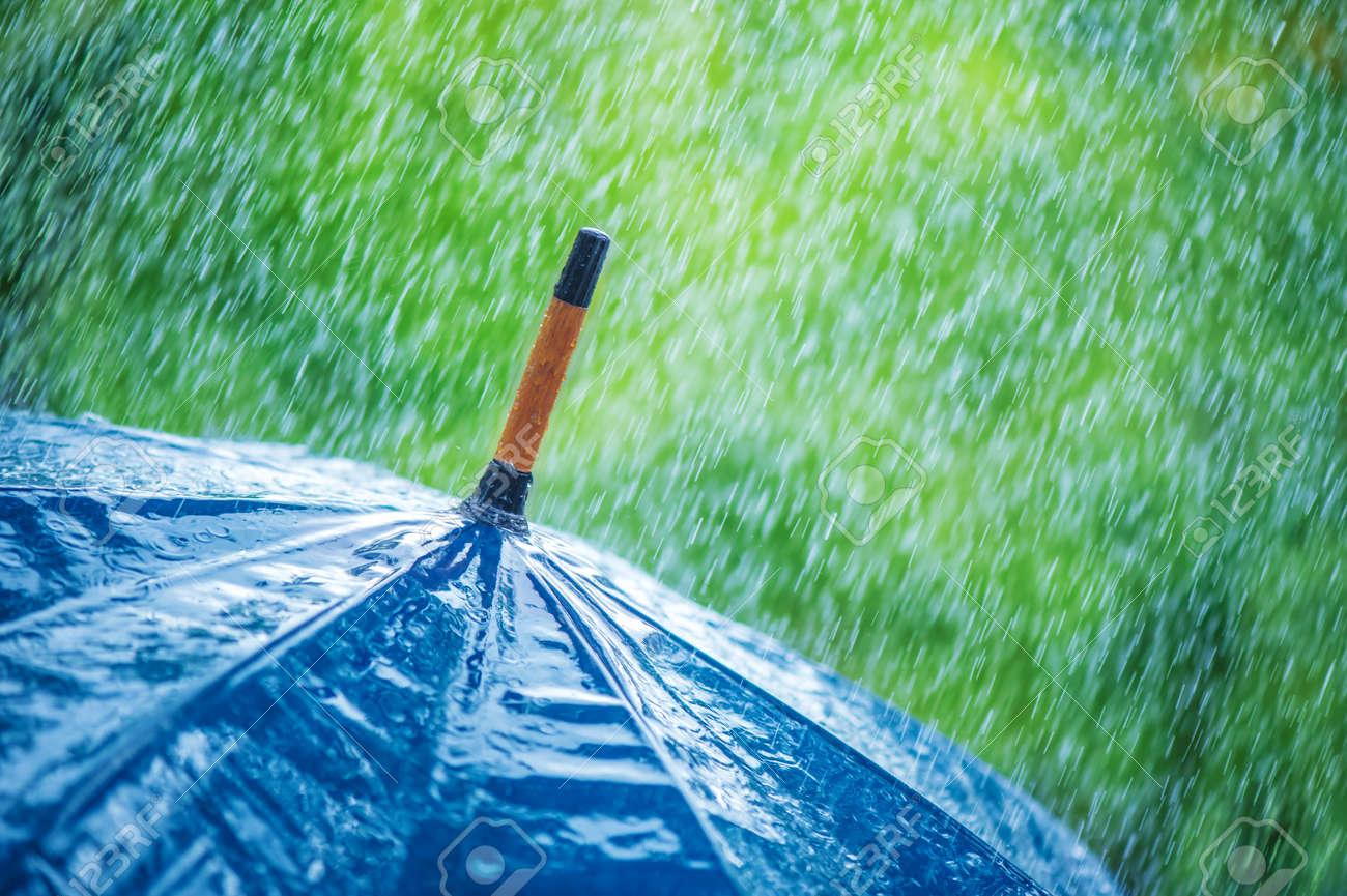 umbrella and rain drops closeup Standard-Bild - 22274893