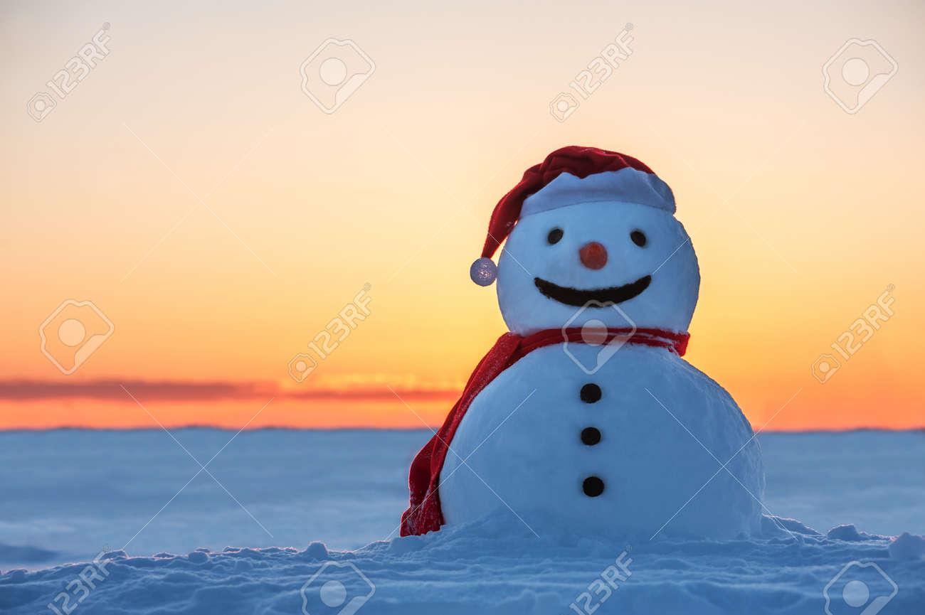 snowman on orange sunset Standard-Bild - 22561500