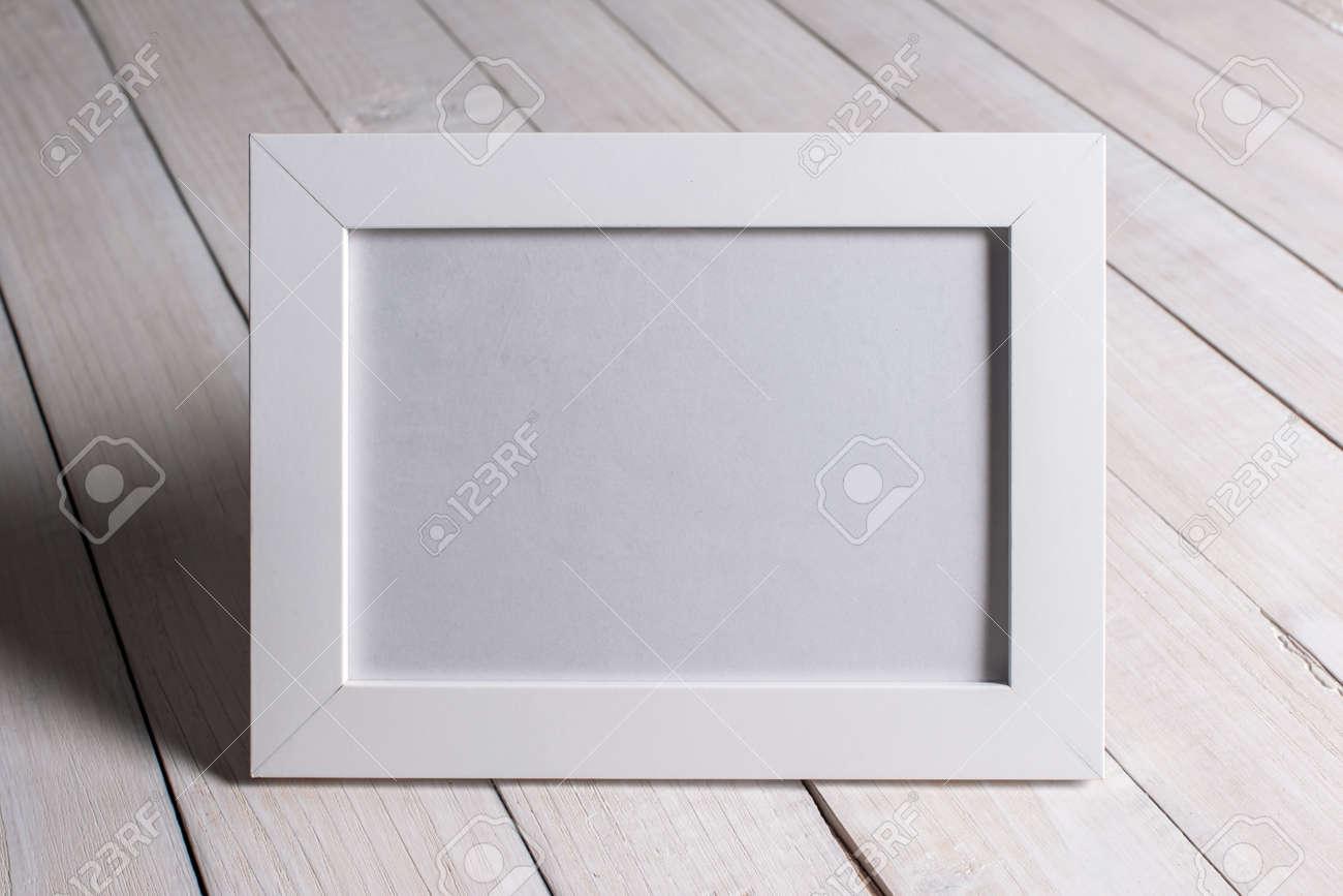 empty photo frame in woman hands Standard-Bild - 23258690