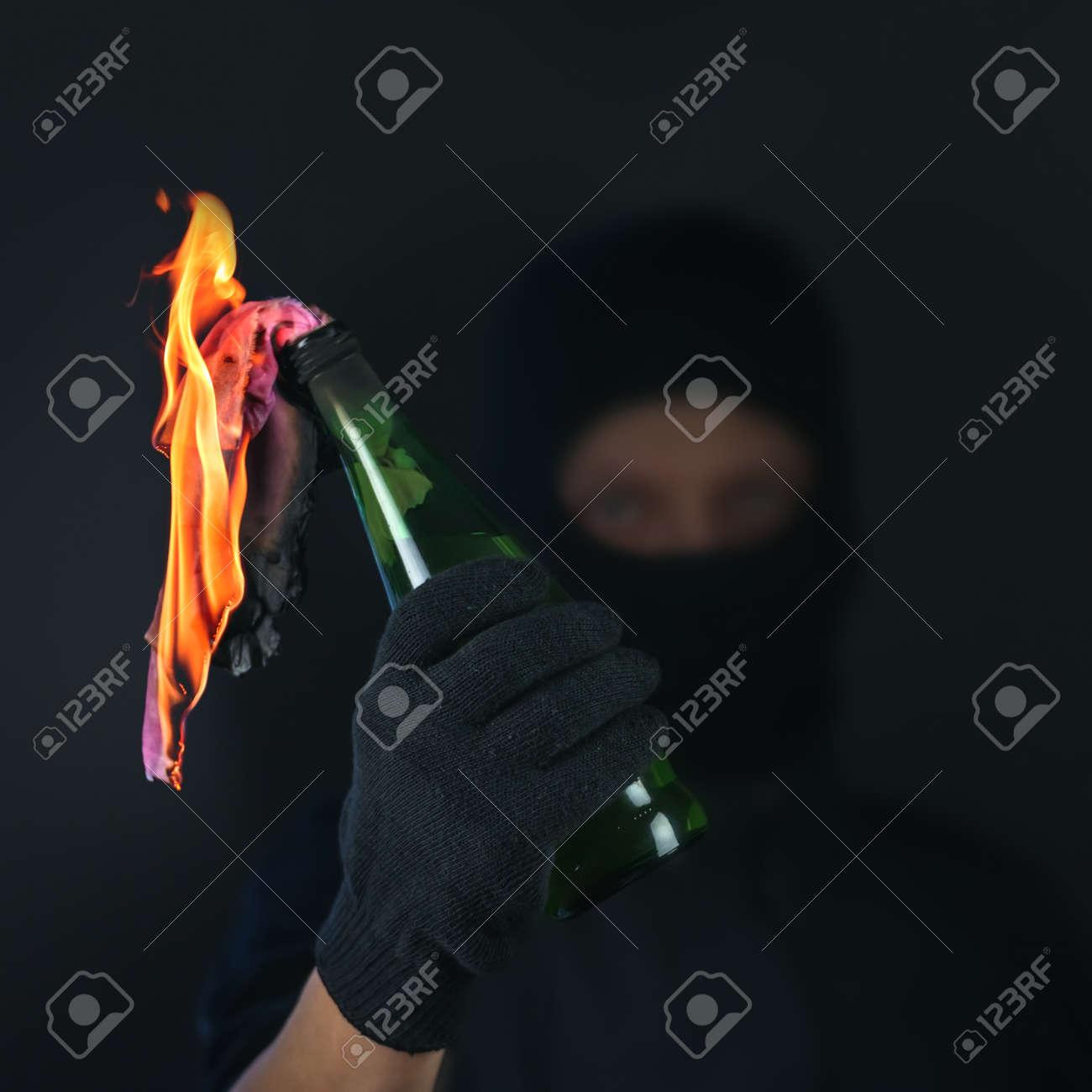 molotov cocktail in activist hand Stock Photo - 26119454
