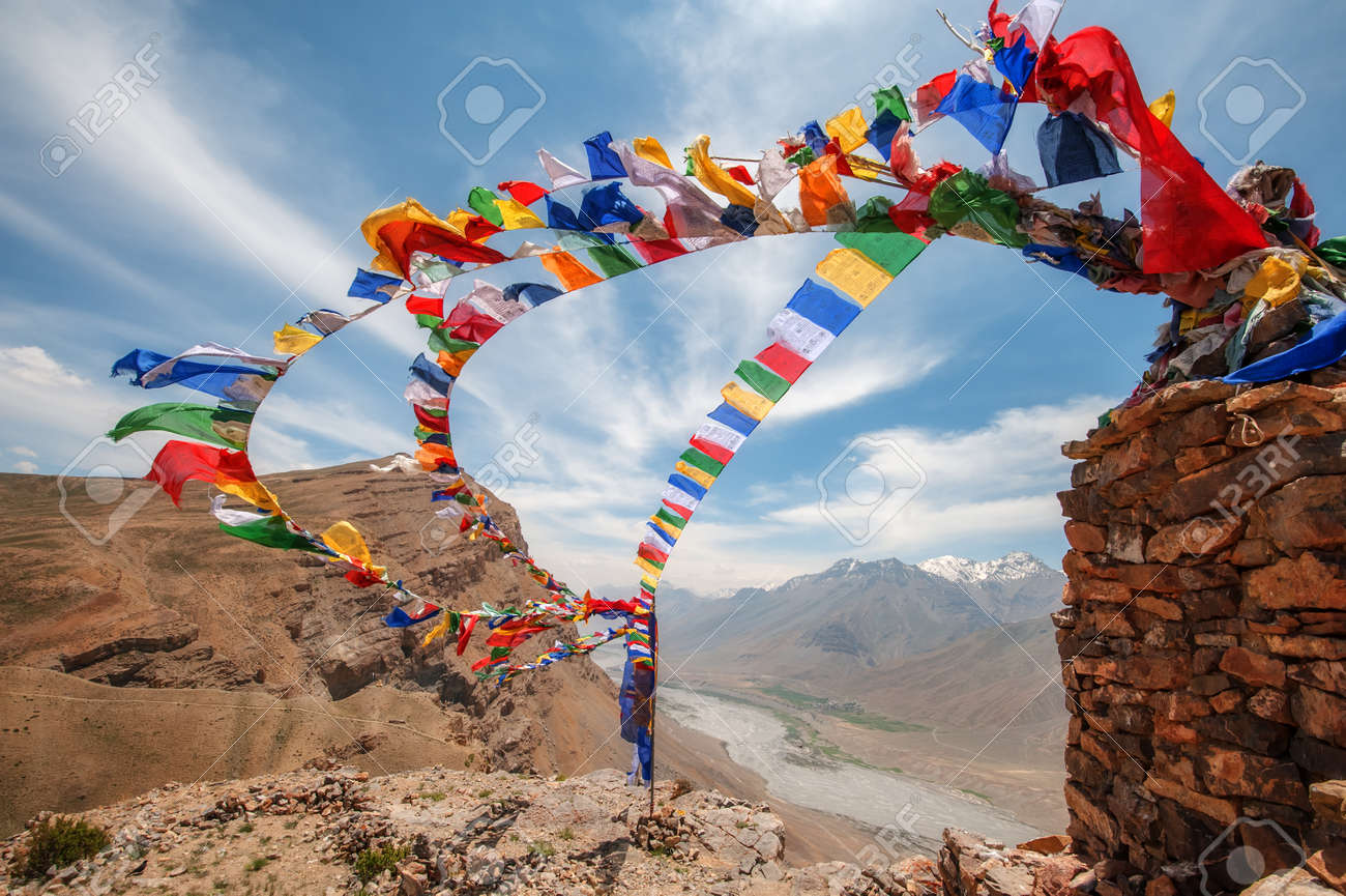 tibetan flags with mantra on sky background - 38589062