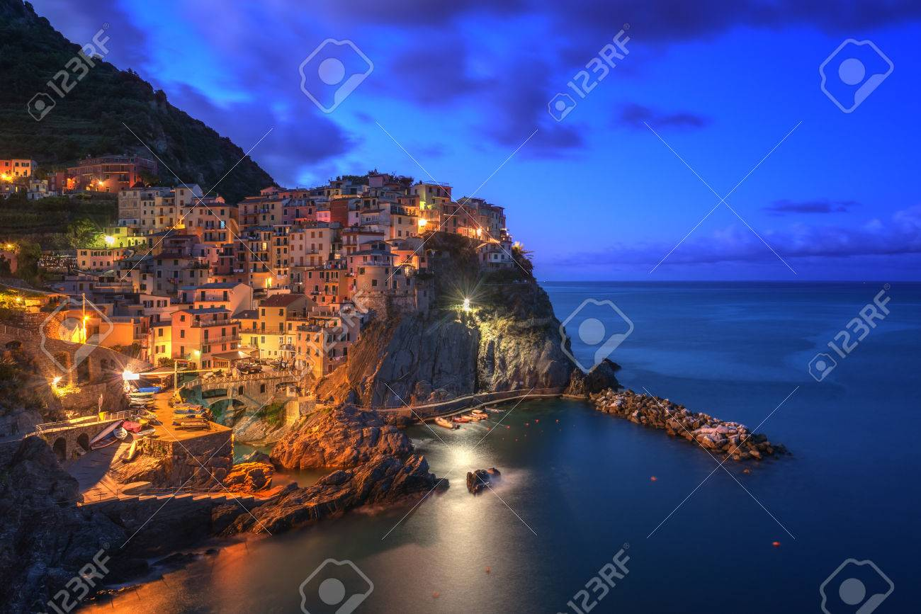 Amazing view of Manarola city at evening light with costal rocks on a foreground. Cinque Terre National Park, Liguria, Italy, Europe. - 44183122