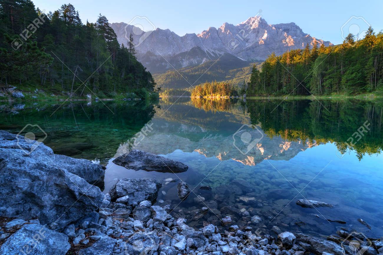 Fantastic sundown on mountain lake Eibsee, located in the Bavaria, Germany. Dramatic unusual scene. Alps, Europe. Standard-Bild - 46069914