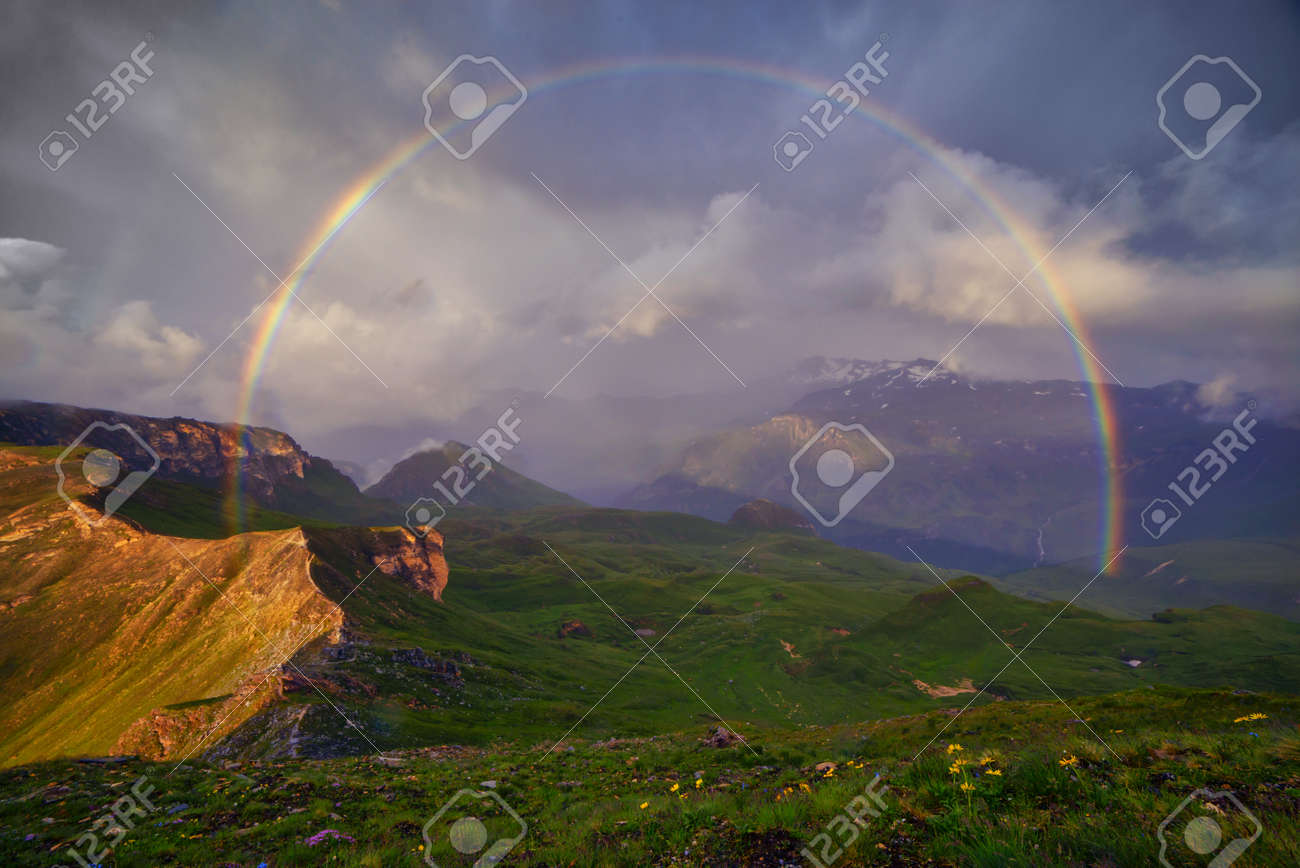 Amazing rainbow on the top of grossglockner pass, Alps, Switzerland, Europe. - 57984831