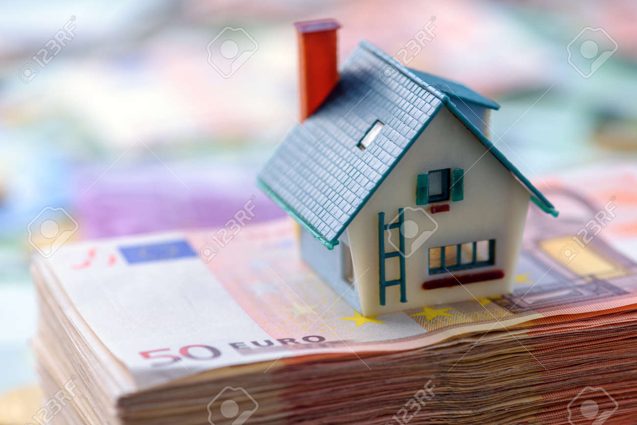 house model on euro cash stack closeup - 64387609