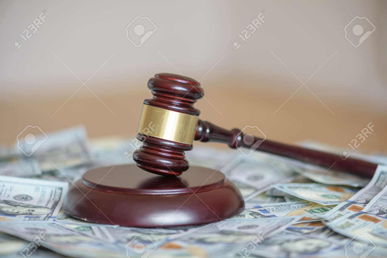 wood gavel on cash background - 64389256