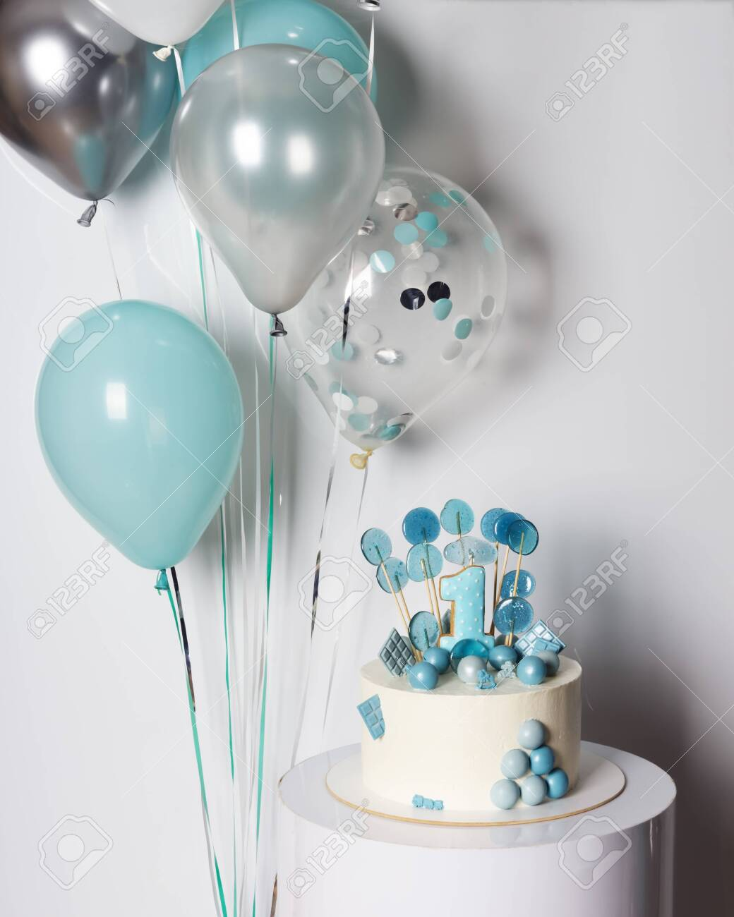 Wondrous White And Blue Cake With Candy And Cookie Number One On Boy First Funny Birthday Cards Online Alyptdamsfinfo