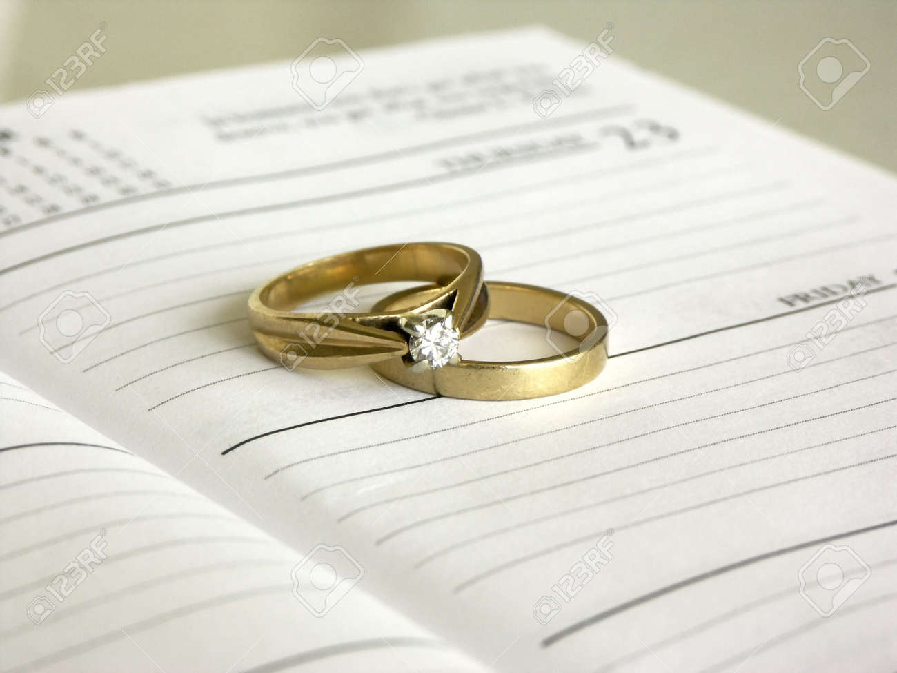 Set Of Wedding Rings On A Date Book ,shallow Dof Stock Photo