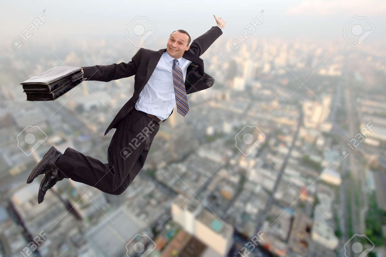 smiling businessman flying over a big city Stock Photo - 2072947