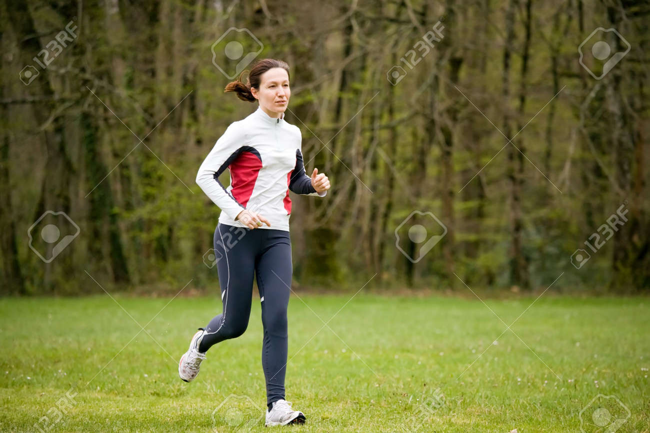 woman running in a park at springtime Stock Photo - 2753640
