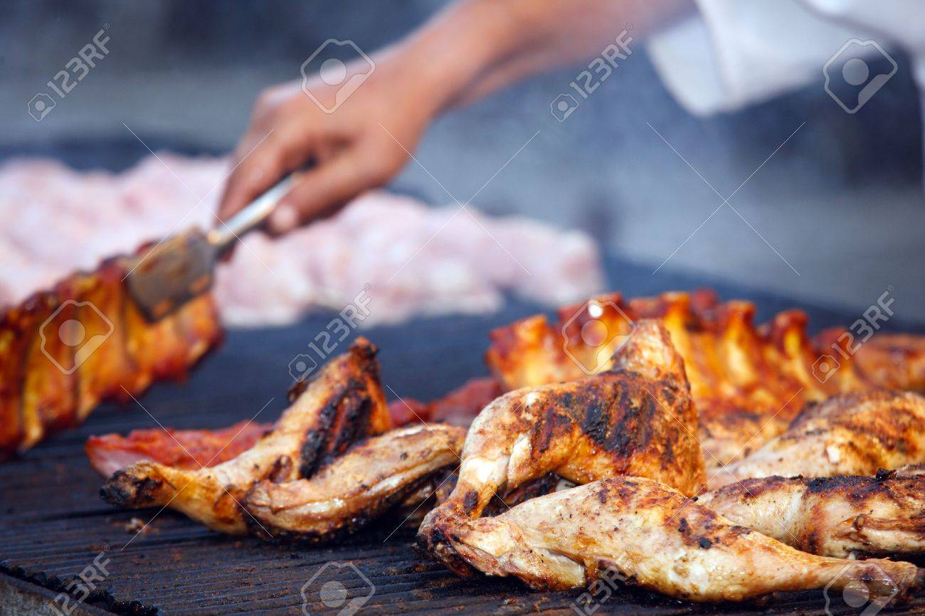 barbecue of grilled chicken legs with chef's hands Stock Photo - 3530297