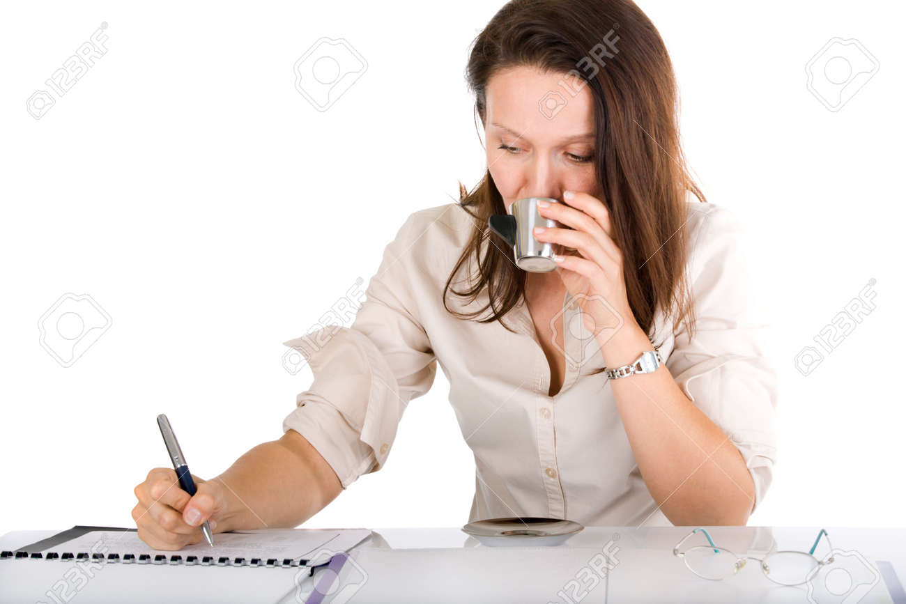 businesswoman drinking coffee while checking notebook Stock Photo - 3604015