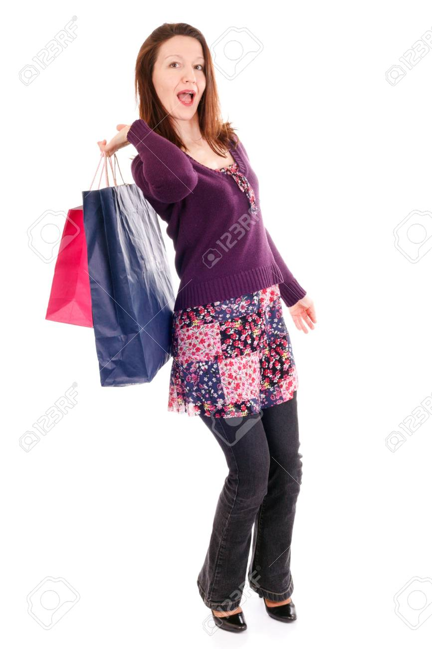 woman holding heavy shopping bags on white background Stock Photo - 3976424