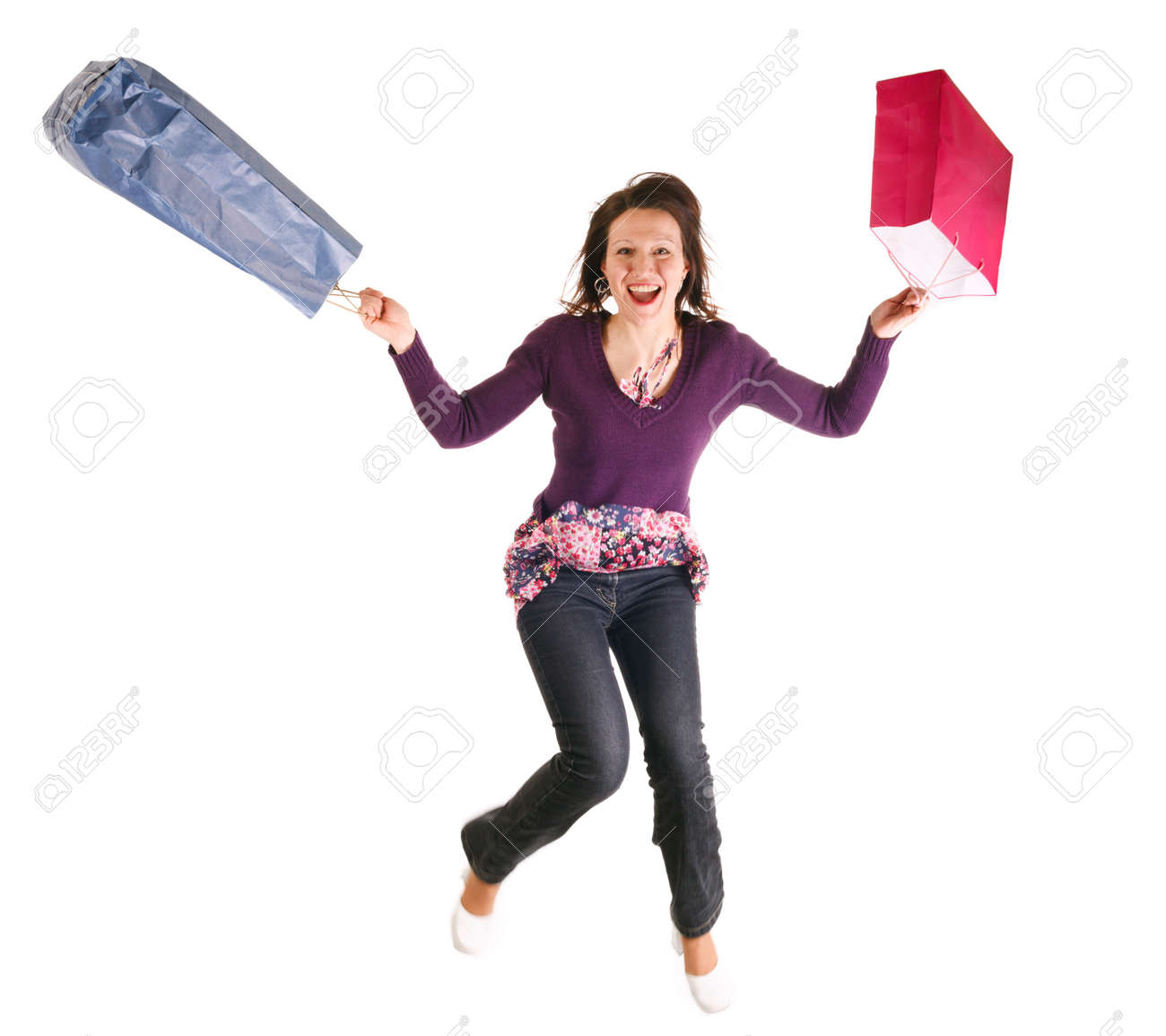happy woman jumping with shopping bags over white background,motion on foots Stock Photo - 3976432