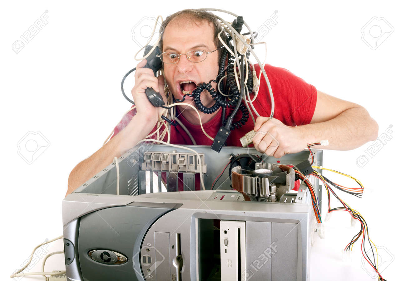 man in panic with his computer trying to reach hotline Stock Photo - 4304970