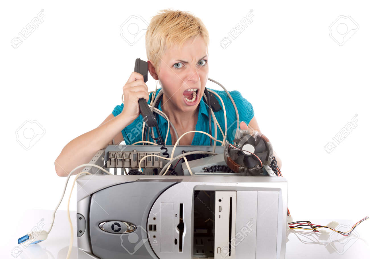 woman having problem with computer calling support on phone Stock Photo - 5077508