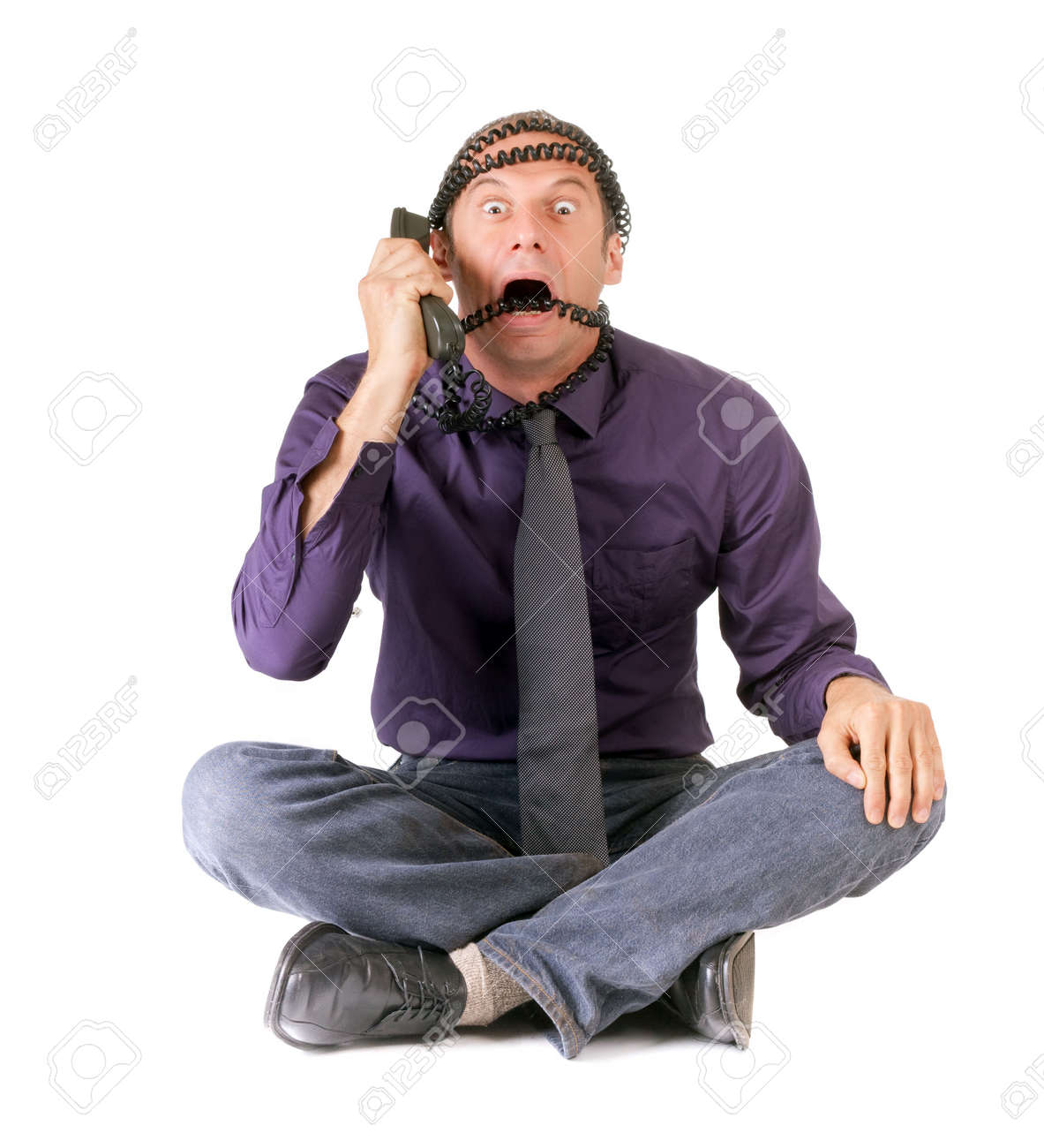 stressed business man talking on phone with cables over head Stock Photo - 5695044