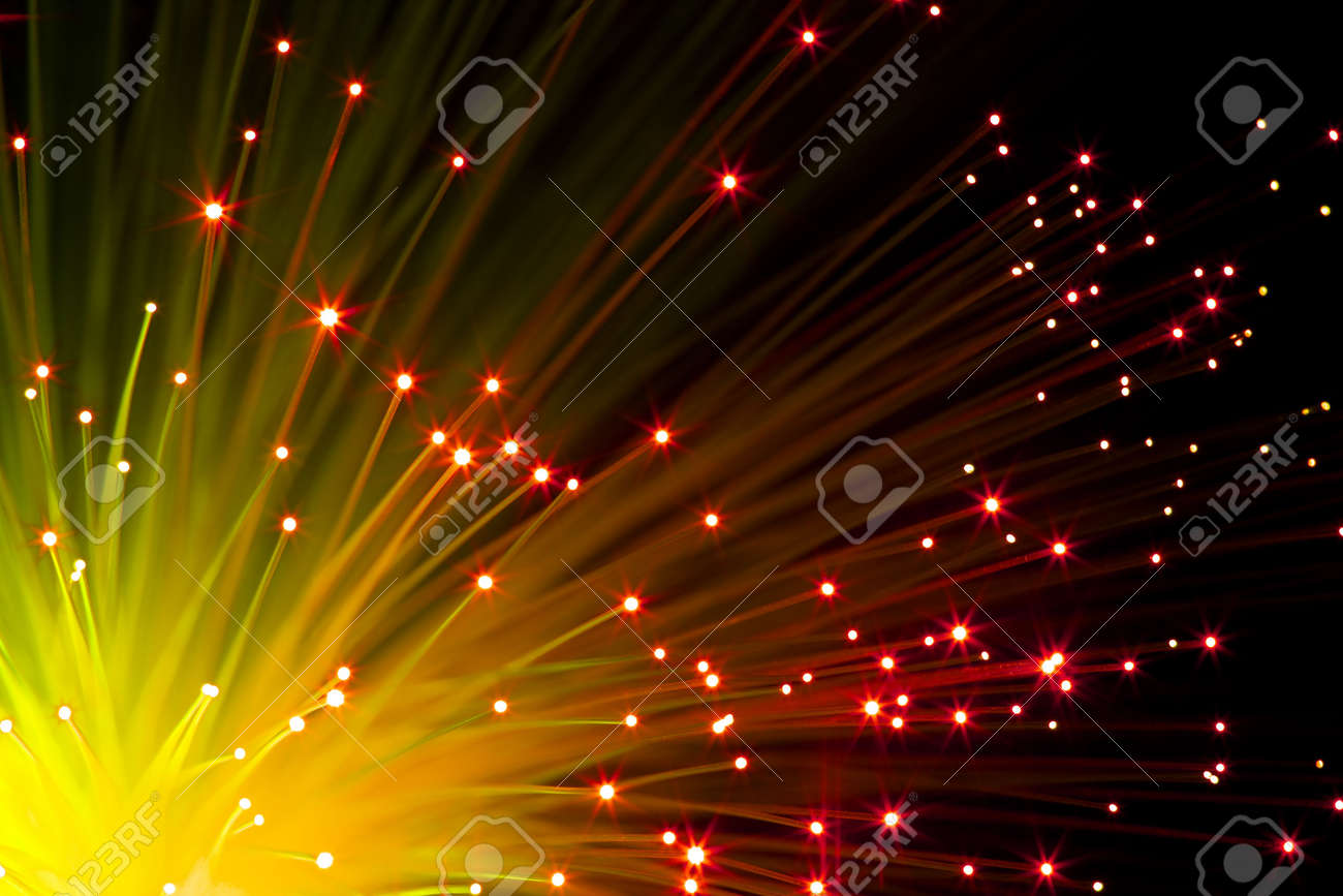 closeup on  illuminated orange optic fibers under black background Stock Photo - 6122384