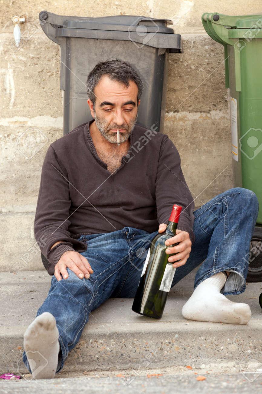 http://previews.123rf.com/images/smithore/smithore1008/smithore100800153/7713114-sad-drunk-man-sitting-on-sidewalk-near-trashcan-Stock-Photo-homeless.jpg