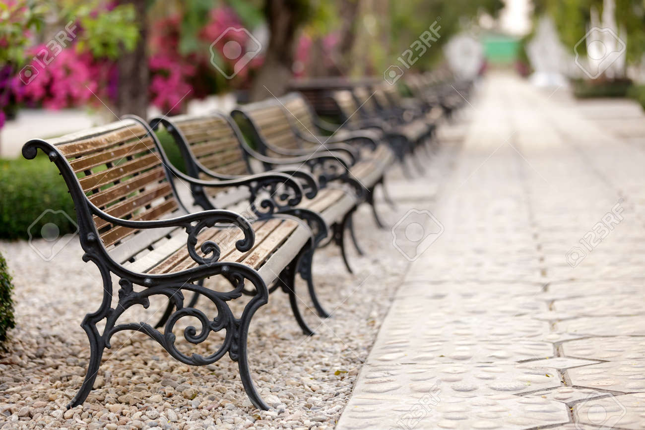 metallic and wooden bench in a row, shallow deep of field selective focus on the first Stock Photo - 9531438