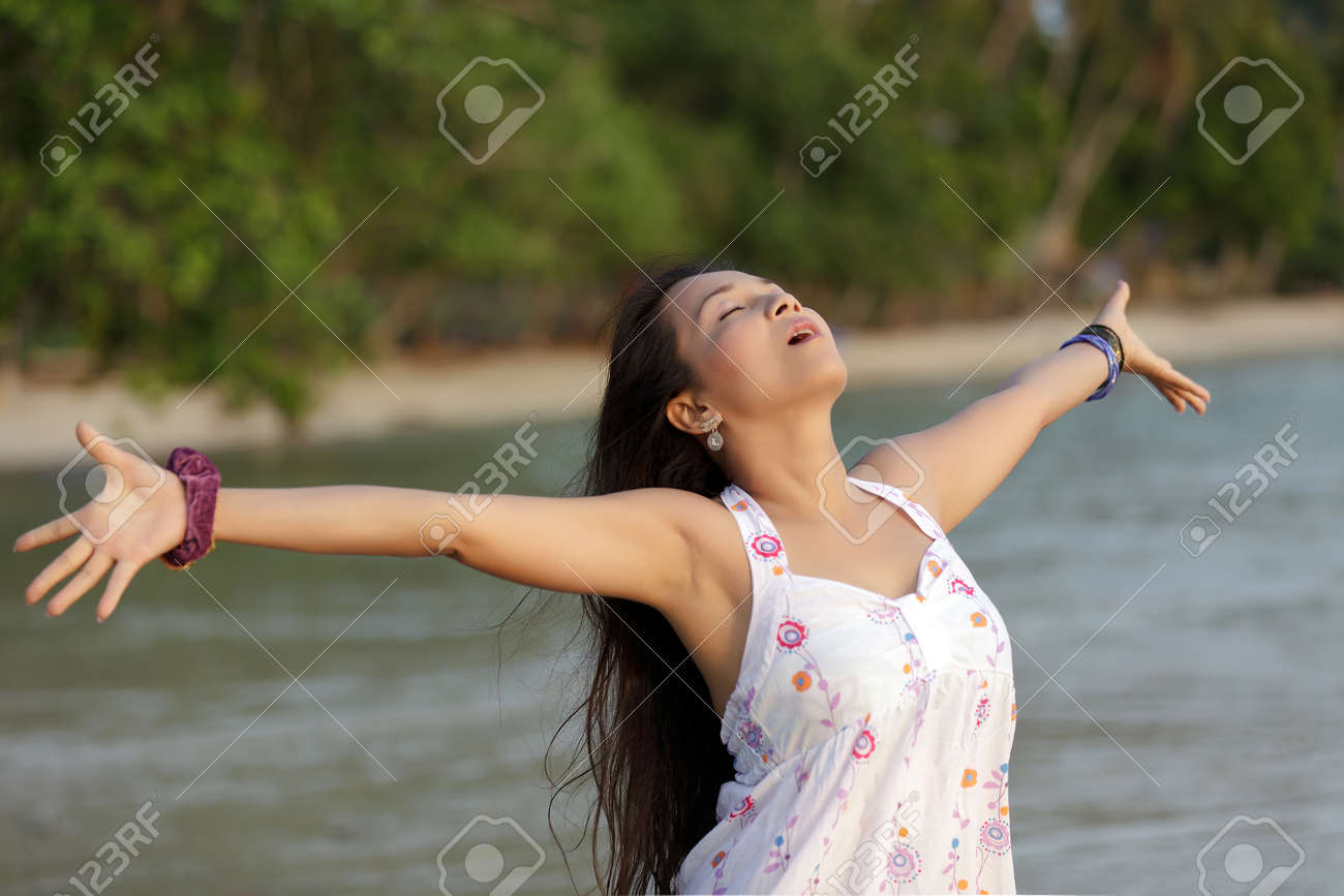 asian woman breathing in thailand tropical beach Stock Photo - 9736639