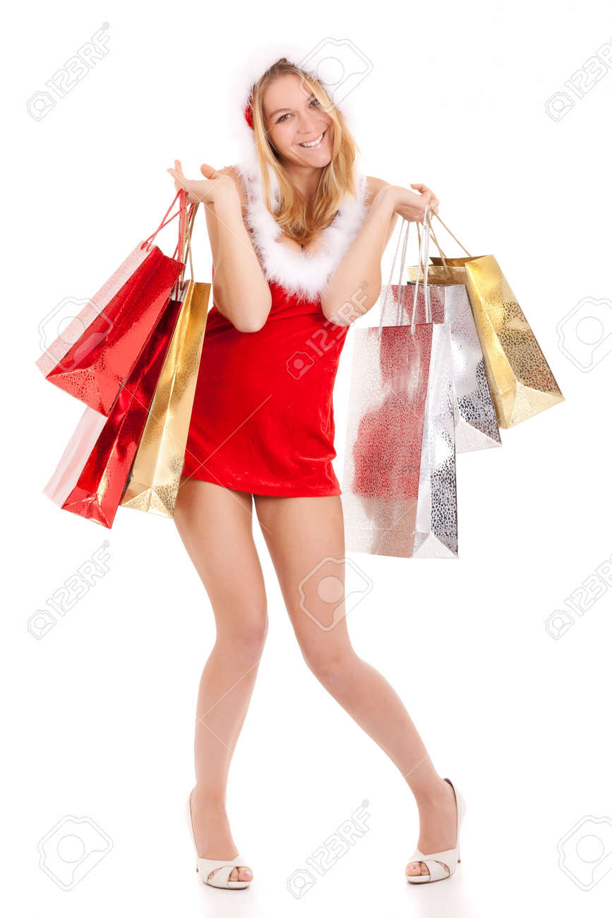 happy young woman in santa suit carrying shopping bags Stock Photo - 10360444