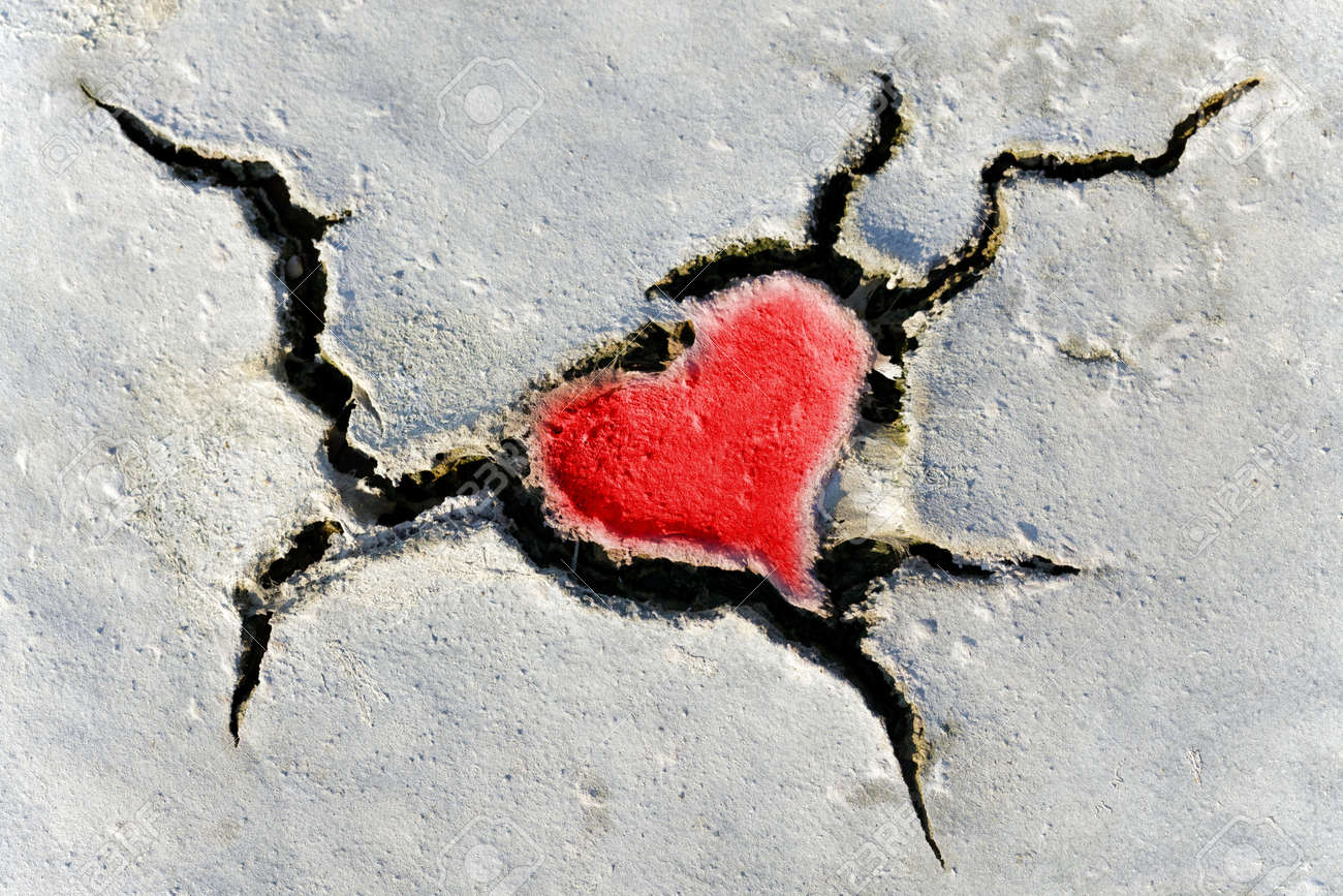Natural Red Heart Shape In Cracked Dry Soil Stock Photo, Picture And ...