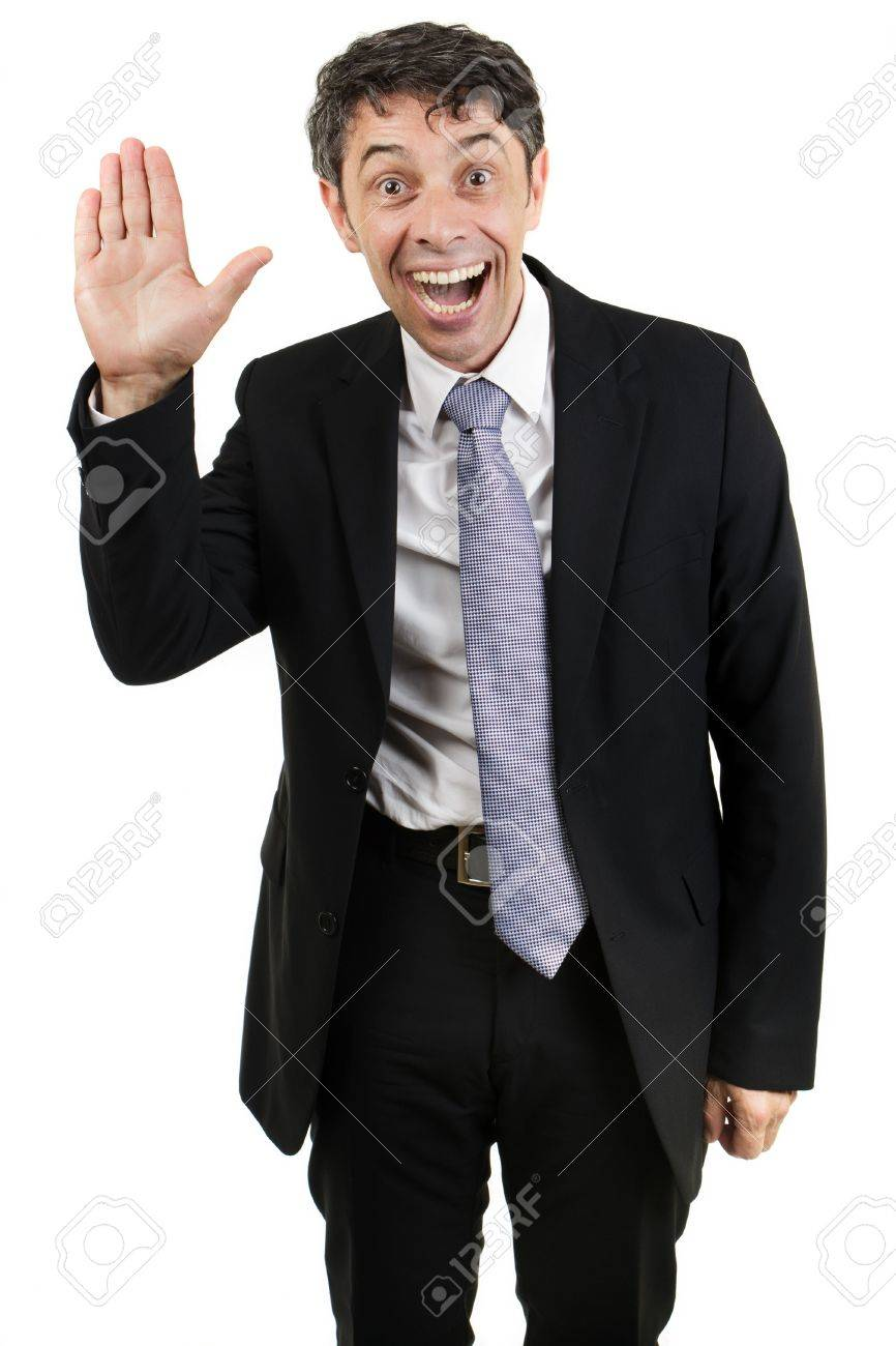 Quirky businessman with an animated expression and mouth open waving hello with the palm of his hand isolated on white Stock Photo - 20537556