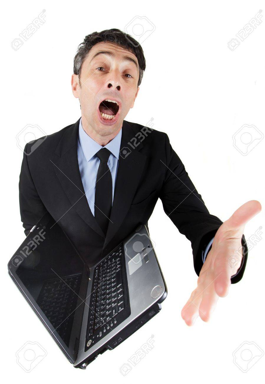 Humorous high angle full length portrait of a loquacious businessman with an open laptop with his mouth wide open and gesturing with his hand while giving a presentation Stock Photo - 20573839