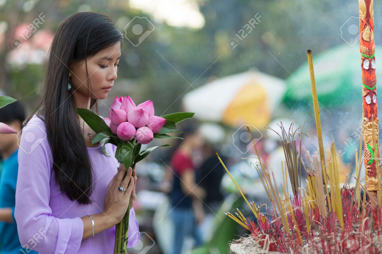 Peace And Beauty In Prayer As A Young Vietnamese Woman Makes An