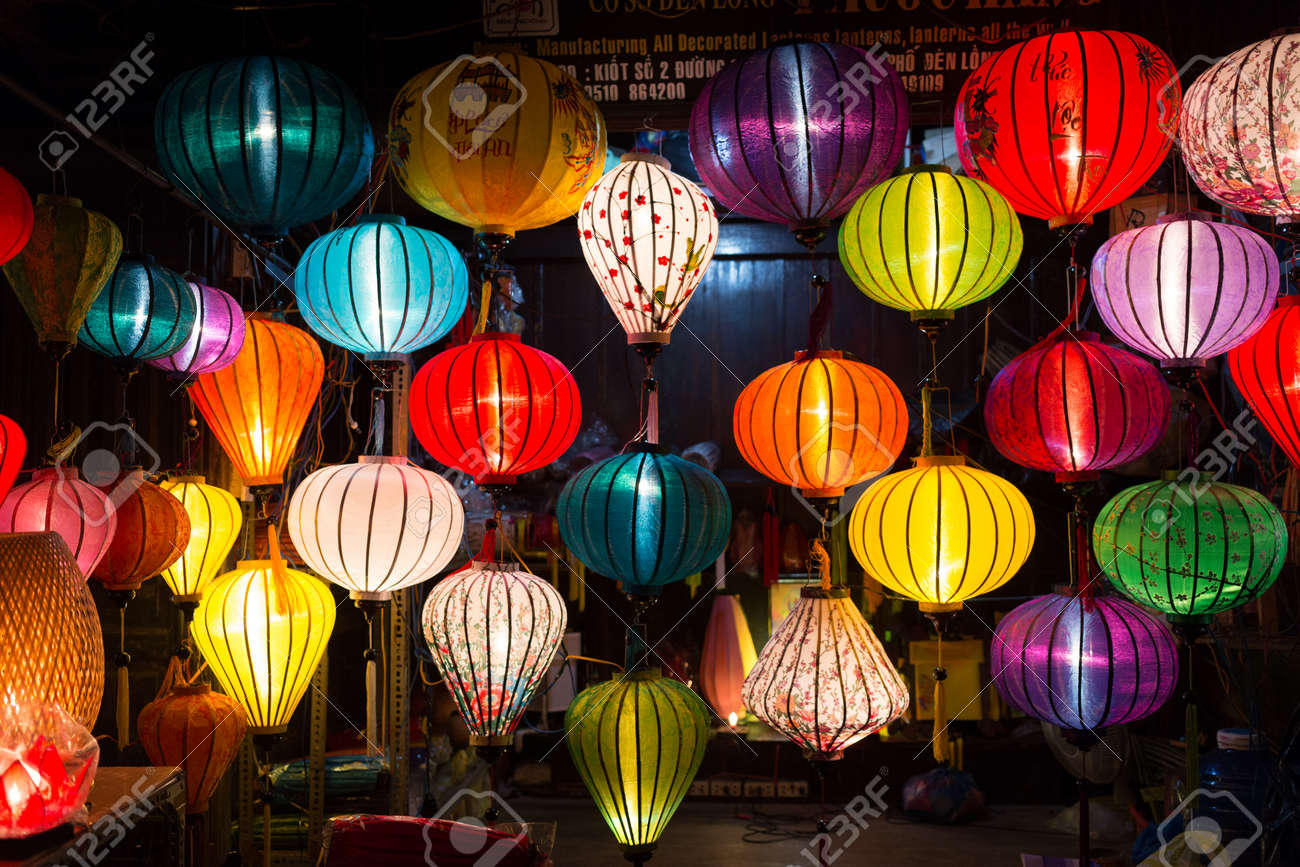 colorful silk chinese style lamps in hoi an shop in vietnam stock