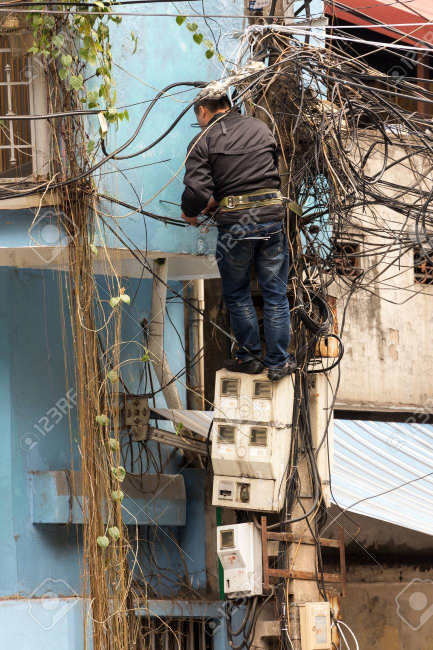 Hanoi Vietnam December 16 2014 A Technician Standing On Stock Free Photography Electric Meter Messy Electrical Installation The Electricity Meters
