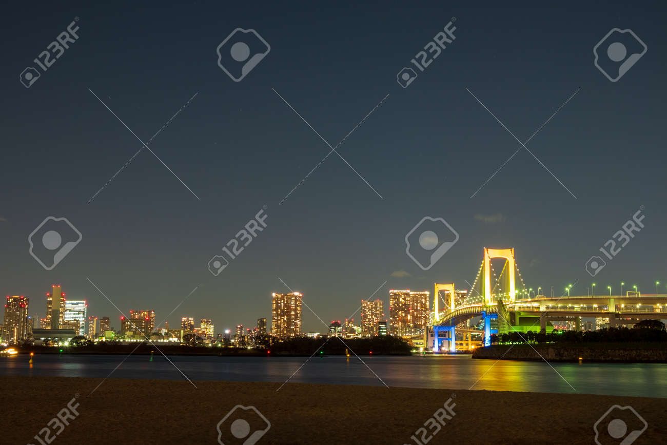 Rainbow Bridge, the large bridge can walk across it and it connects the central part of Tokyo and Odaiba - 132082360